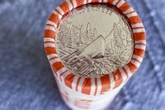 A roll of newly released Frank Church River of No Return Wilderness quarters is photographed on Wednesday, Nov. 6, 2019, following a ceremony at Salmon Junior-Senior High School in Salmon, Idaho, Salmon, Idaho. The coin is the 50th in the U.S. Mint's America the Beautiful series of quarters. The coin shows a drift boat pilot navigating the wild River of No Return among its features. (© 2019 Cindi Christie/Cyanpixel)