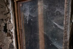 A dusty window offers a glimpse into this structure's interior,
